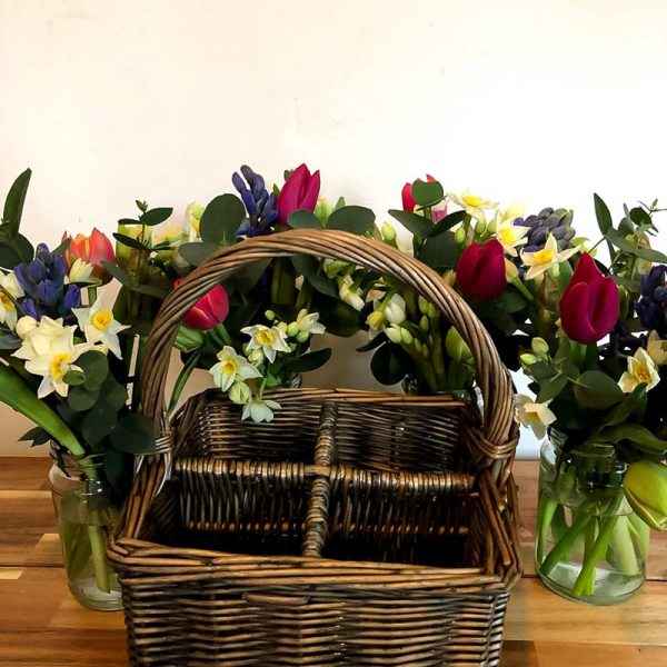 Basket and 4 jam jar posies of Mother's Day flowers